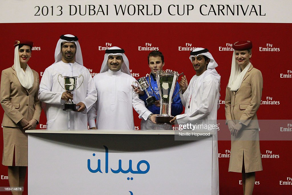 Trainer Saeed bin Suroor, Majid Al Mualla, Senior Vice President of Emirates Airlines Commercial Operations, jockey William Buick and Sheikh Juma Al Maktoum attend the Sajjhaa presentation after winning the Group 1 Jebel Hatta race during Super Saturday at Meydan Racecourse on March 9, 2013 in Dubai, United Arab Emirates.