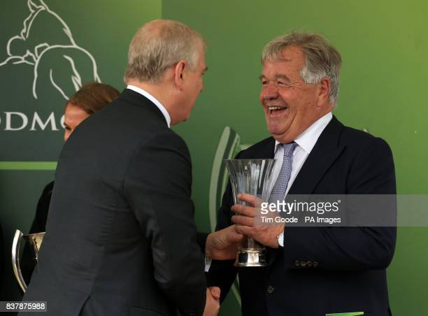 Trainer Sir Michael Stoute receives the trophy from the Duke of York after his horse Ulysses won the Juddmonte International Stakes during Juddmonte...