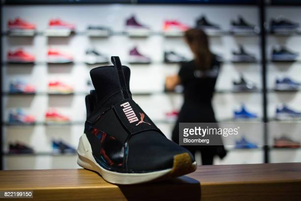 A trainer sits on display inside a Puma SE sportswear clothing store in Berlin Germany on Tuesday July 25 2017 Puma increased its fullyear forecasts...