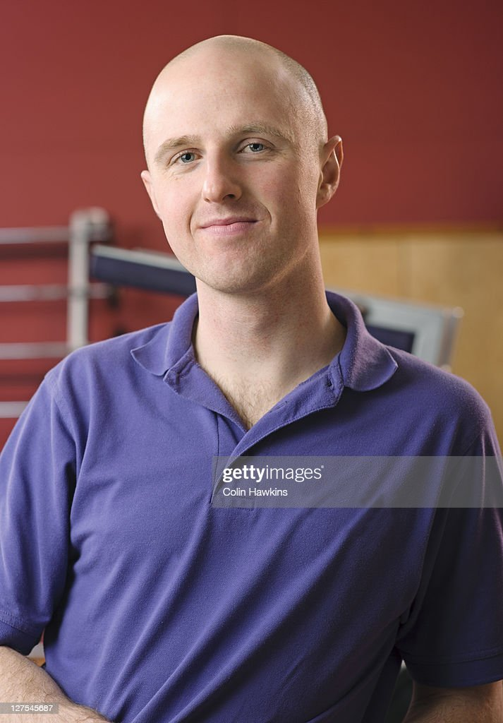 Trainer smiling in gym : Stock Photo