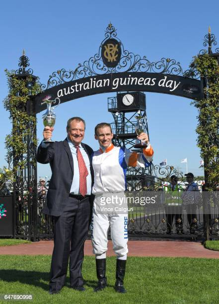 Trainer Tony Mc Evoy and jockey Luke Currie pose with trophy after Hey Doc won Race 7 Australian Guineas during Melbourne Racing at Flemington...