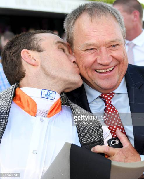 Trainer Tony Mc Evoy is kissed by jockey Luke Currie after Hey Doc won Race 7 Australian Guineas during Melbourne Racing at Flemington Racecourse on...