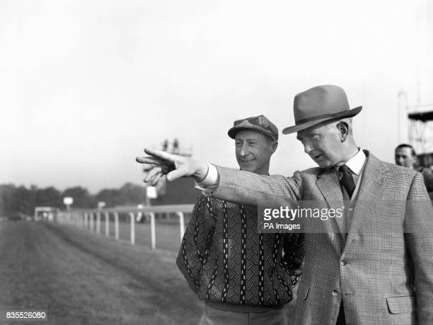 Trainer Vincent O'Brien gives a few preDerby tips to jockey Pat Glennon on the course at Epsom In the 1962 Derby Stakes this afternoon Glennon will...