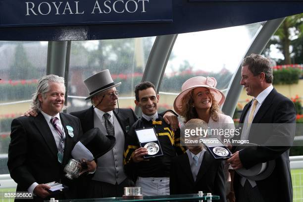 Trainer W A Ward Owners Mitch Dutko and Ray Sainz pose with jockey John Velazquez after Strike The Tiger wins the Windsor Castle Stakes at Ascot...