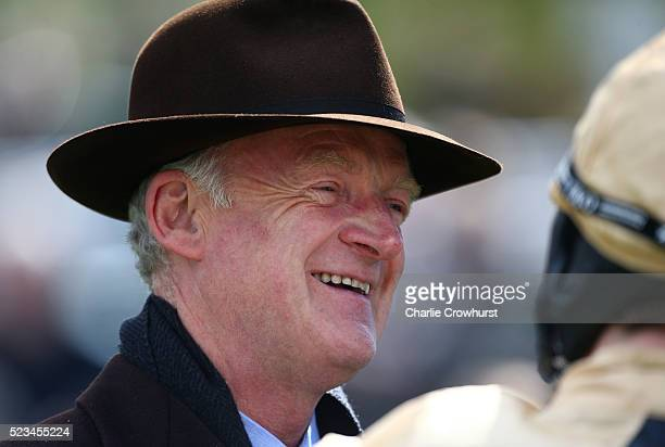 Trainer Willie Mullins looks on in the parade ring ahead of the first race at Sandown racecourse on April 23 2016 in Esher England
