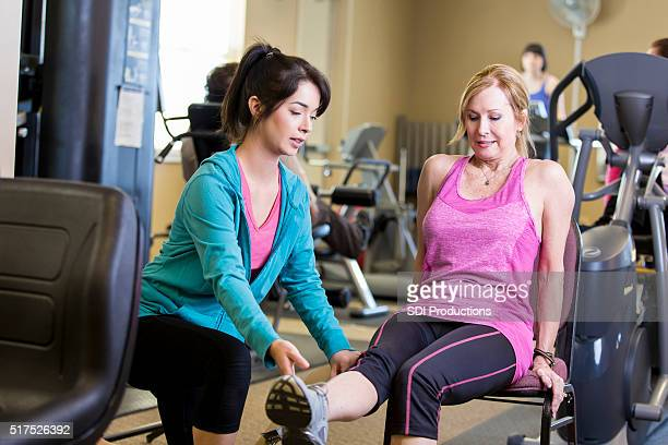 Trainer works with senior woman