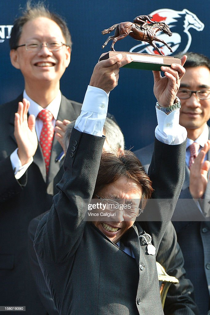 Trainer Yasuda Takayuko from Japan lifts up the trophy after Lord Kanaloa won The Longines Hong Kong Sprint during the Hong Kong International Races at Sha Tin racecourse on December 9, 2012 in Hong Kong.