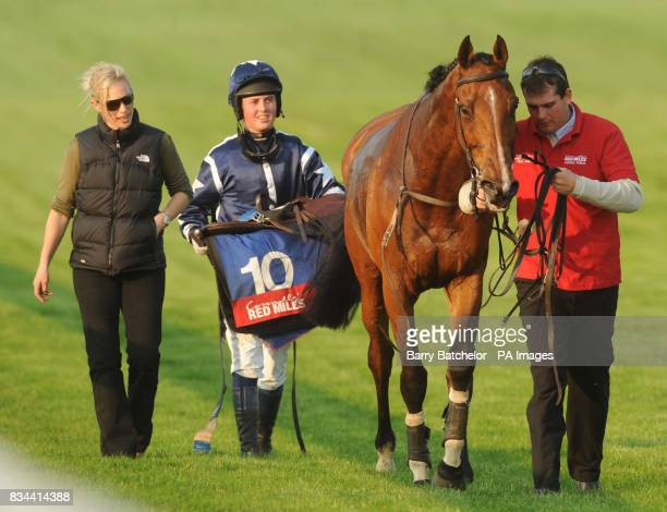 Trainer Zara Phillips walks off the course with jockey Tom David and her horse Manor Down after they failed to finish in the Connolly's Red Mills...
