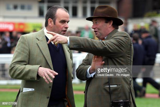 Trainers Alan King and Nicky Henderson chat in the parade ring during day two of The April Meeting at Cheltenham Racecourse
