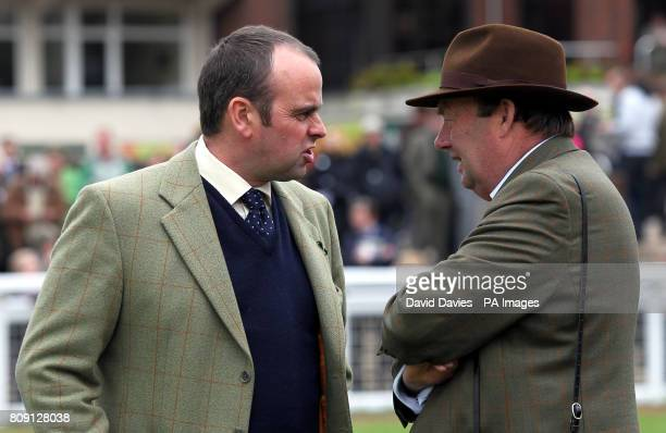 Trainers Alan King and Nicky Henderson in the parade ring during day two of The April Meeting at Cheltenham Racecourse