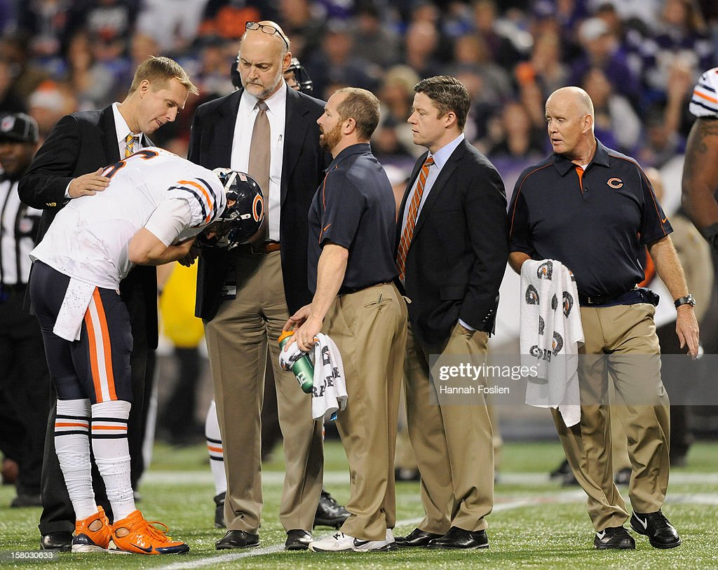 Trainers check on Jay Cutler #6 of the Chicago Bears during the fourth quarter of the game against the Minnesota Vikings on December 9, 2012 at Mall of America Field at the Hubert H. Humphrey Metrodome in Minneapolis, Minnesota. The Vikings defeated the Bears 21-14.