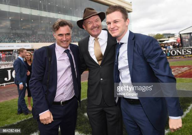 Trainers David Hayes Tom Dabernig and Ben Hayes after Boom Time won Race 8 Caulfield Cup during Melbourne Racing on Caulfield Cup Day at Caulfield...