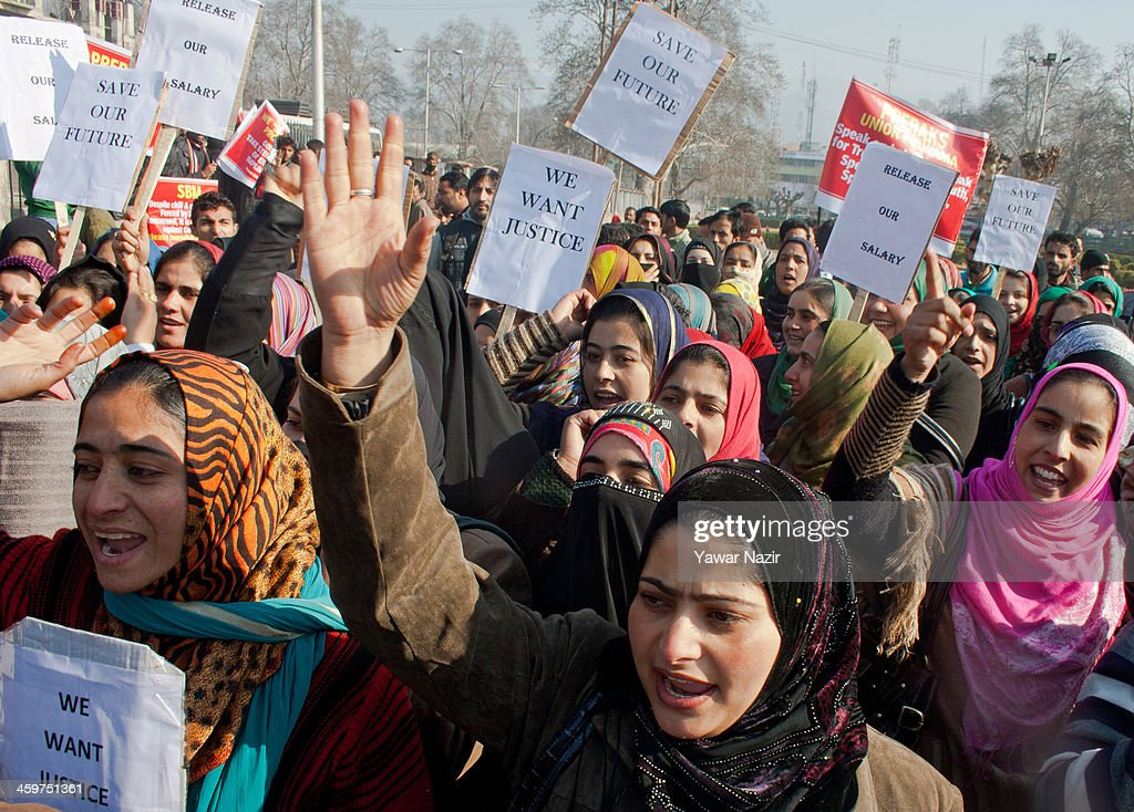 Trainers (Preraks) employed under Sakshar Bharat Mission, a scheme sponsored by Indian government shout slogans during a protest against the government for not paying their salaries on December 30, 2013 in Srinagar, the summer capital of Indian administered Kashmir, India. Dozens of Preraks employed under the scheme, sponsored by the Indian government, were injured after Indian police attempted to disperse the crowd using batons. The group was protesting against the Government for non-payment of their honorarium, due for the last two years.