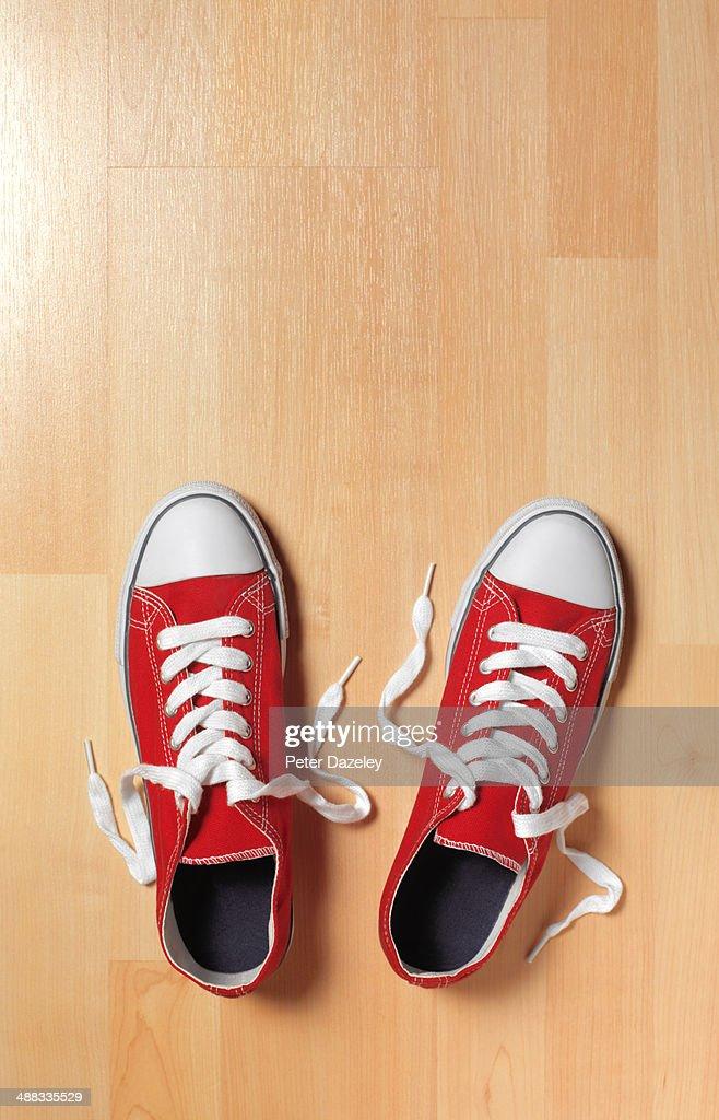 Trainers on wooden floor