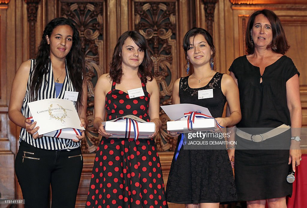 Training and employment commission President Anne Repic (R), stands next to laureates of the ''Concours General'' in the category ''Fashion-Clothing'', (LtoR) first-placed Asmae Qossini, second-placed Morgane Salmon and third-placed Elodie Bona at the Sorbonne University on July 8, 2013 in Paris. The prestigious competition, created in 1744, distinguishes every year the best students. In 2013, 130 prizes were awarded to 126 students. AFP PHOTO / JACQUES DEMARTHON