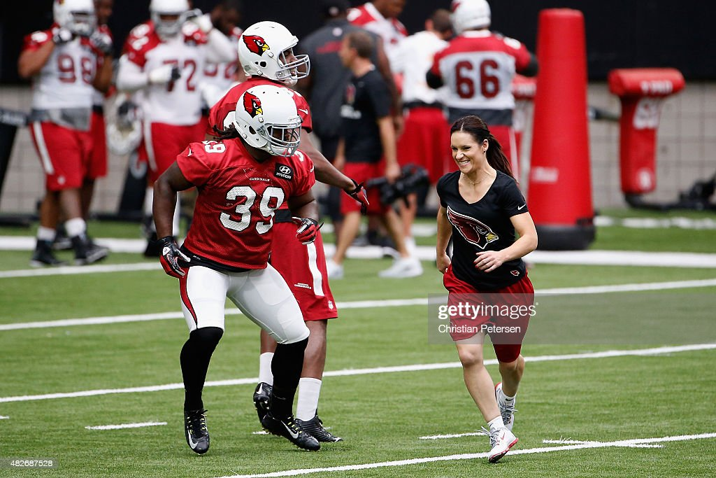 Training camp coach Jen Welter of the Arizona Cardinals participates in on-field drills during a team training camp at University of Phoenix Stadium on August 1, 2015 in Glendale, Arizona.