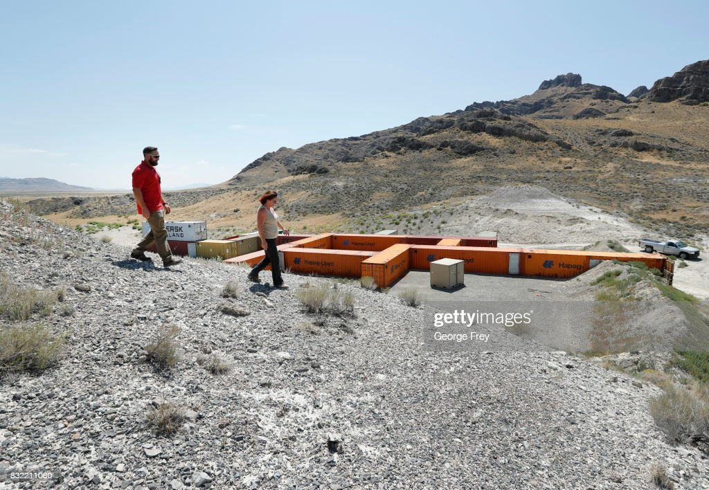 Training coordinator Jennifer Cavalli (R) Derek Schumann of Jacobs Engineering Group walk a hillside above the newly created BRAUCH training facility at the U.S. Army's Dugway Proving Ground on August 15, 2017 in Dugway, Utah. The BRAUCH facility is made up of old shipping containers that are hooked together to simulate an underground environment such as caves and tunnel complexes, so military units such as special forces can train for those environments.