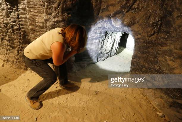 Training coordinator Jennifer Cavalli shines a light into a secondary tunnel in the newly created BRAUCH training facility at the US Army's Dugway...