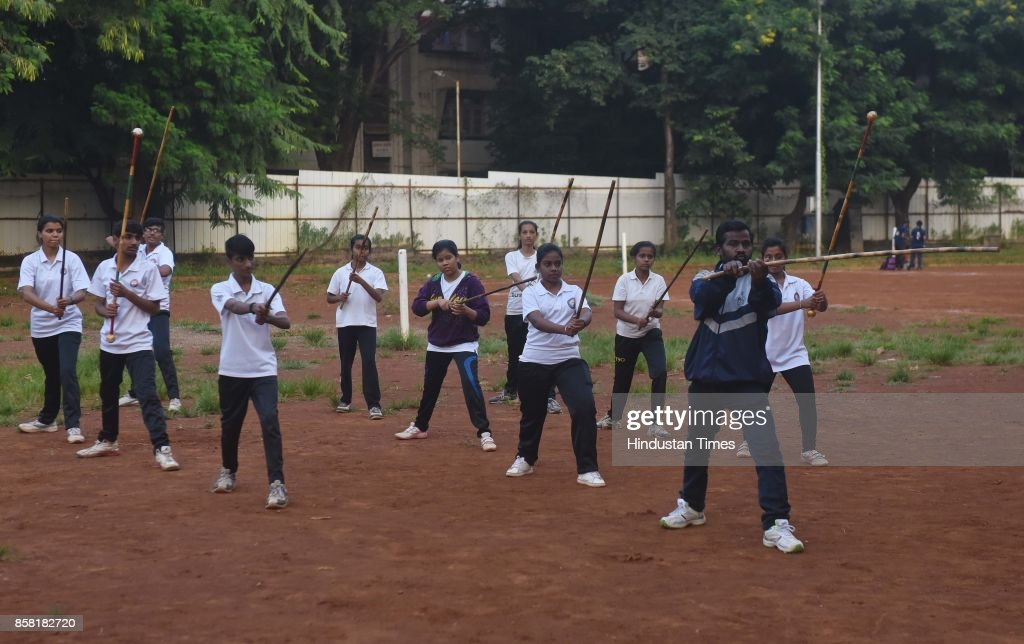 Training session of Silambam, a weapon based Indian Martial arts, on October 4, 2017 in Pune, India. The word Silambam means either a mountain or merely to sound (as verb). While the Silambam fencers are fighting, the weapon makes sound. This might have been the cause for its being named as Silambam.