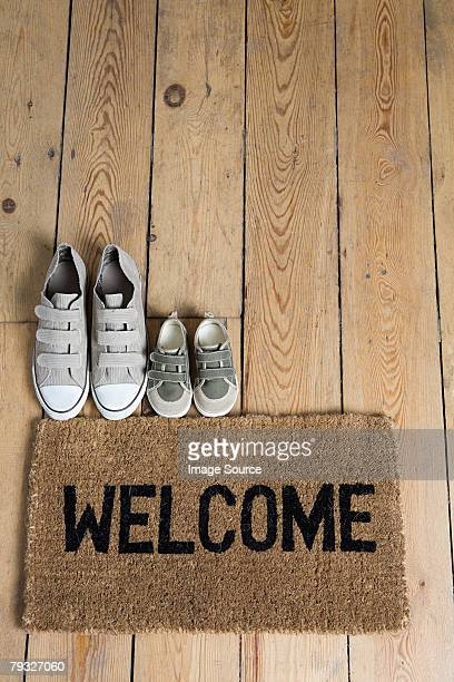 Training shoes and a welcome mat