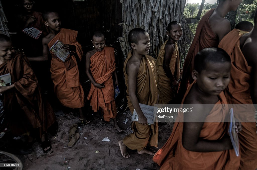 Training Theravada buddhist monks finish their morning lessons conducted from a makeshift bamboo hut and make their way back to the local village pagoda, in Char Chouk Village, Varin District, Cambodia, on June 29, 2016.
