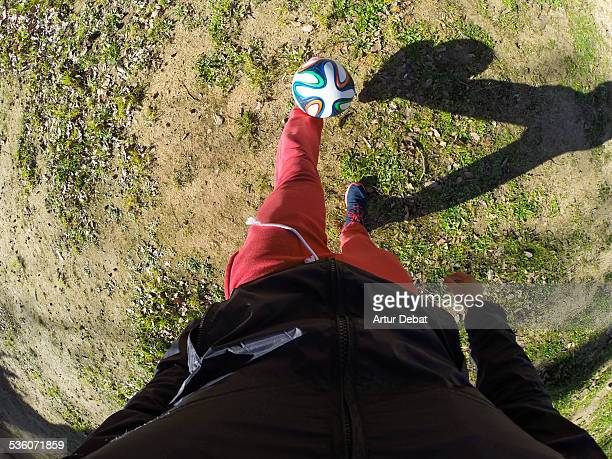 Training with football ball doing tricks from personal point of view
