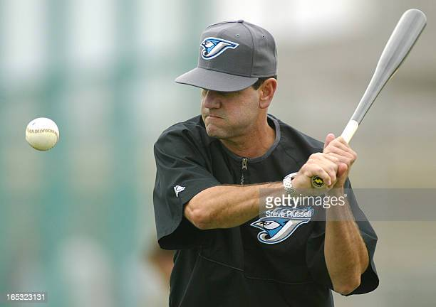TRAINING02/26/04Carlos Tosca hits balls to his outfielders as the Toronto Blue Jays continue to workout at The Toronto Blue Jays Dunedin Florida...
