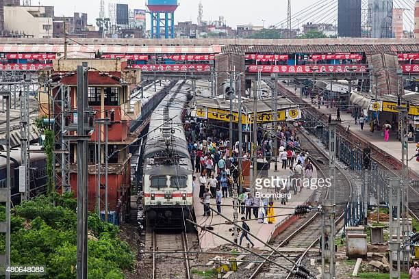 Trains and commuters stand at the Patna Junction railway station in Patna Bihar India on Friday July 10 2015 Anyone placing bets on whether Indian...
