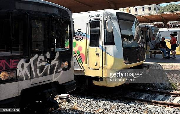 Trains are seen stopped at a Rome overland subway station on July 15 2015 For the past several days the Rome subway timetable has been hit with...