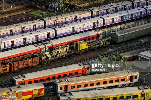 Trains pass each other on the tracks in the Lower Parel area of Mumbai India on Monday May 11 2015 Mumbai's longcherished dream of becoming another...