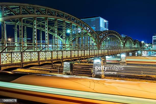 Trains passing by Munich Hacker Bridge at night