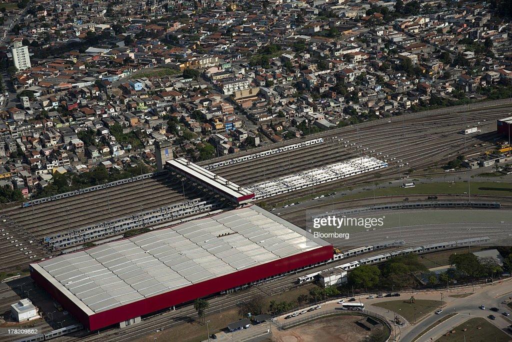 Trains sit in a rail yard next to the Itaquera train and subway station in this aerial photo taken in Sao Paulo, Brazil, on Friday, Aug. 23, 2013. Home sales in Sao Paulo, Brazils biggest real-estate market, rose 46 percent in January through June from a year earlier, while housing starts climbed 51 percent, according to Embraesp, a property research group, and Secovi, a real-estate agency association. Photographer: Paulo Fridman/Bloomberg via Getty Images