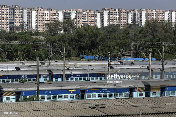 Trains stand at Lokmanya Tilak Terminus in Mumbai India on Saturday Jan 28 2017 India's Finance Ministry will recommend bold tax reform to ensure...