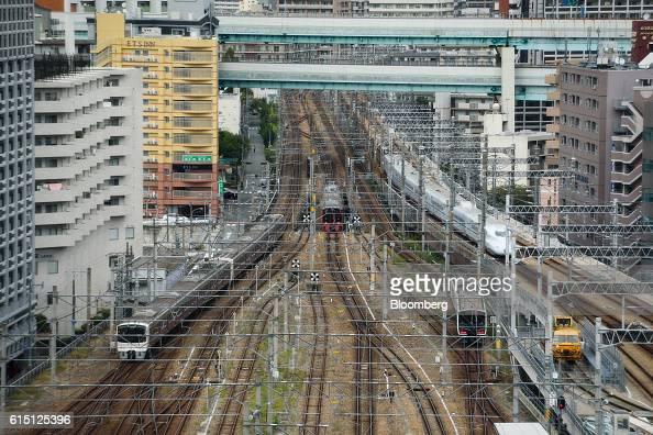 Trains travel along tracks as they approach Hakata Station in Fukuoka Fukuoka Prefecture Japan on Tuesday Oct 11 2016 Kyushu Railway Co the...
