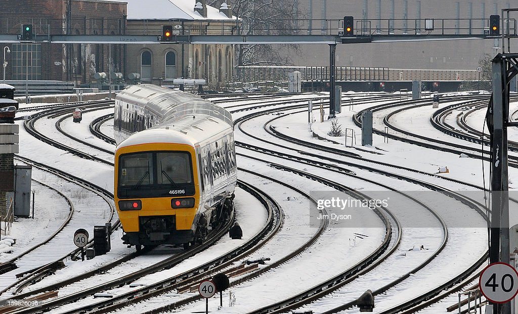 Trains travel in and out of Victoria station on January 21, 2013 in London, United Kingdom. The United Kingdom has suffered a weekend of heavy snowfall with transport routes affected including the cancellation of many rail services.