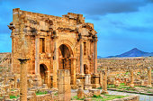Trajan's Arch within the ruins of Timgad, UNESCO heritage in Algeria.