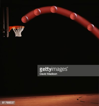 Trajectory of basketball going through basketball hoop.