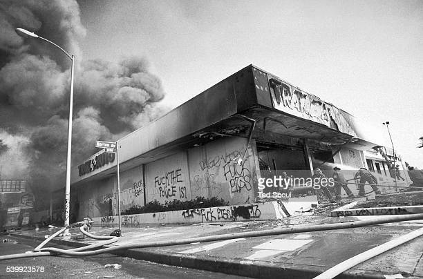 A Trak Auto store is looted and burned on Washington Blvd near Norton Los Angeles has undergone several days of rioting due to the acquittal of the...
