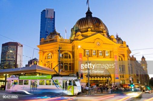 Tram and Flinders Street Station at dusk