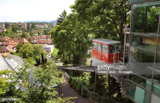 A tram carries passengers down a hillside in Bern Switzerland a host city in this years Euro 2008 football championship