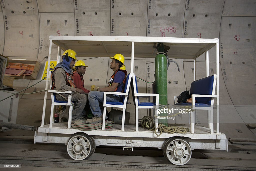 A tram carries workers to their job site inside the Tunnel Emisor Oriente (TEO), or Eastern Discharge Tunnel, during construction of the 38 mile (62km) underground wastewater treatment tunnel in Mexico City, Mexico, on Thursday, Sept. 12, 2013. The tunnel, which is expected to be completed in 2014, will boost Mexico City's drainage capacity to help prevent flooding during rainy season and the over-exploitation of groundwater resources. The project is being managed by Mexico's National Water Commission, Conagua. Photographer: Susana Gonzalez/Bloomberg via Getty Images