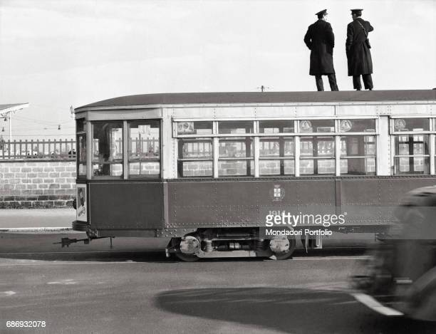 Tram drivers standing on a tram to see inside the San Siro racecourse This picture is taken from the monography 'Mario De Biasi Il mio sogno Š qui'...