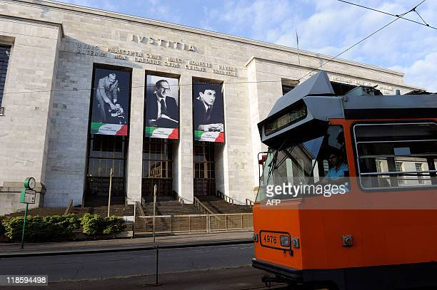 A tram drives past the Milan court house on July 9 2011 A Milan court ordered Italian premier Silvio Berlusconi's Fininvest company today to pay...