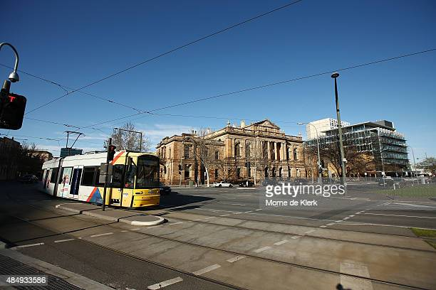 A tram drives past the Supreme Court building in Adelaide's Victoria Square General views of Adelaide on August 23 2015 in Adelaide Australia