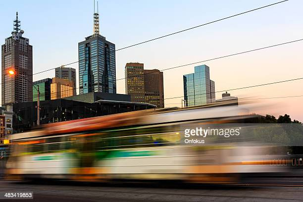 Tram in motion at Sunset, City of Melbourne, Australia