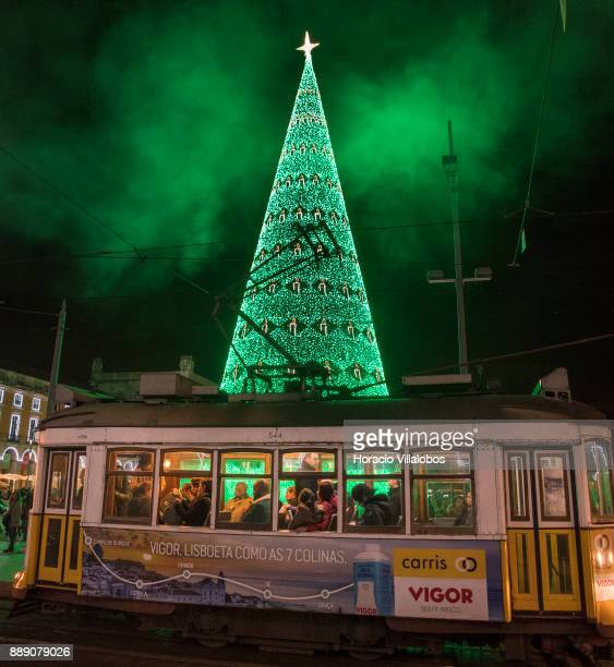 A tram is seen by the large Christmas tree and Christmas and New Year light displays in Praca do Comercio on December 9 2017 in Lisbon Portugal The...