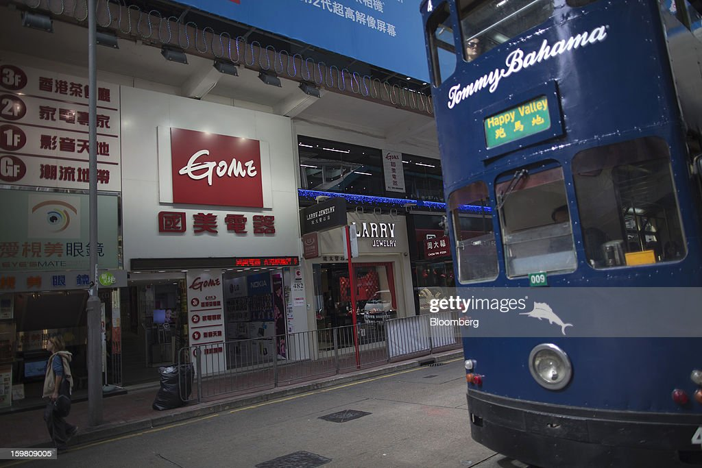 A tram moves past the entrance of a Gome-branded store in the shopping district of Causeway Bay in Hong Kong, China, on Monday, Jan. 21, 2012. Gome Electrical Appliances Holding Ltd. tumbled 5.1 percent in Hong Kong after confirming a report it is closing Gome-branded stores in the city. Photographer: Jerome Favre/Bloomberg via Getty Images