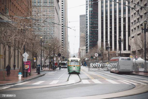 Tram On Track Amidst Buildings In City
