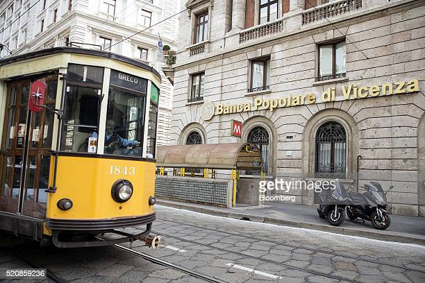 A tram passes a Banca Popolare di Vicenza branch in Milan Italy on Wednesday April 13 2016 The latest plan to address Italian banks' growing bad debt...