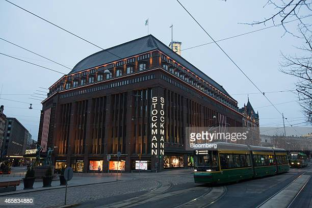 A tram passes a Stockmann Oyj department store in Helsinki Finland on Monday March 9 2015 Finland needs to ensure slower wage growth than in...